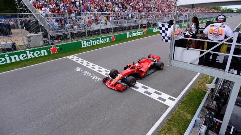 Vettel menyentuh garis finish di posisi pertama GP Kanada (ist)