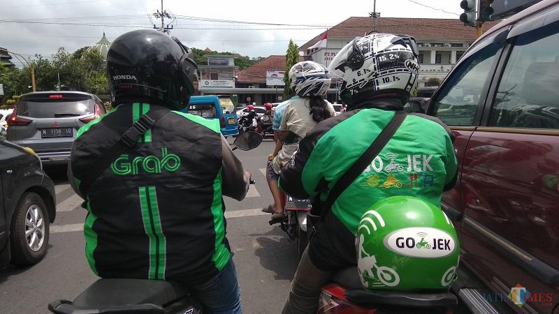 Grab vs Gojek, dua ojek online terbesar di Indonesia (ist)