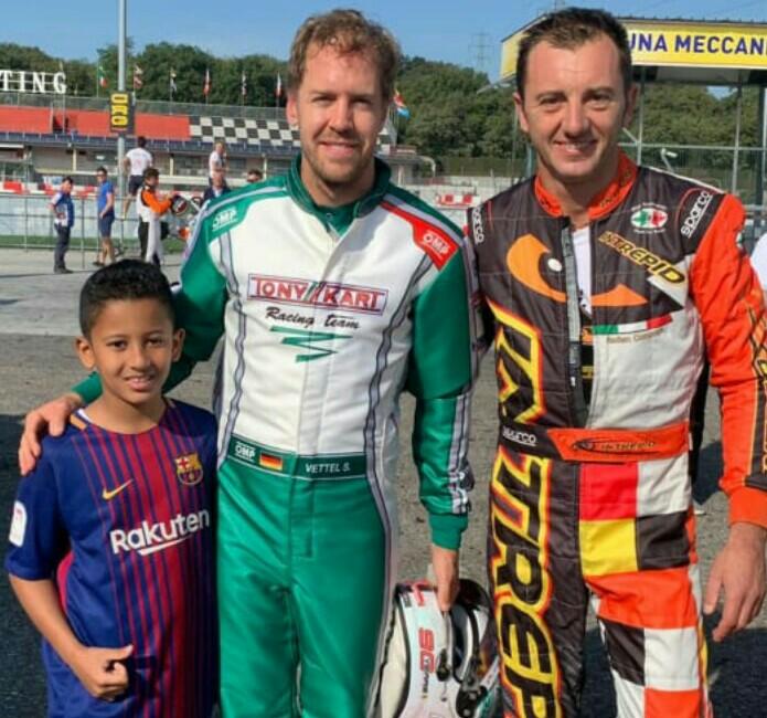 Qarrar Firhand bersama pembalap F1 tim Ferrari Sebastian Vettel dan Davide Fore