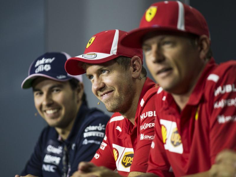 Sebastian Vettel (tengah) diapit Sergio Perez dan Kimi Raikkonen. (Foto: planetf1)