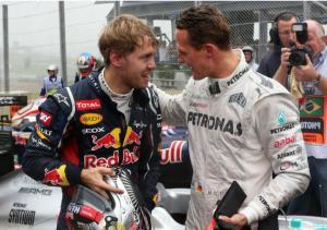 Sebastian Vettel muda bersama sang hero Michael Schumacher di grid F1. (Foto: planetf1)
