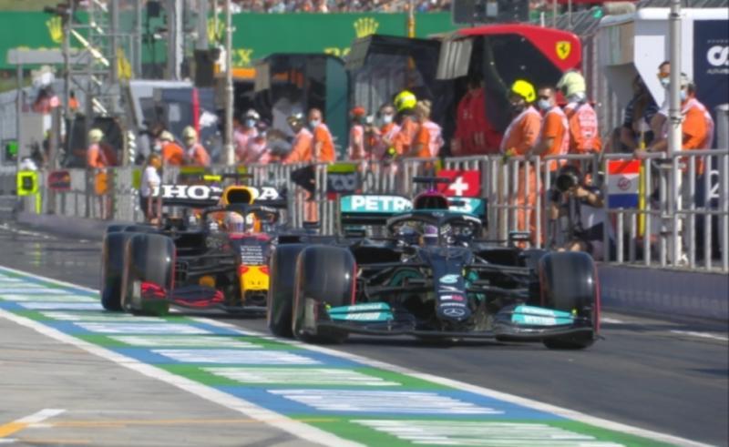 Lewis Hamilton melambat saat out lap menghalangi Max Verstappen di pit lane Sirkuit Hungaroring. (Foto: ist)