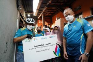 Penyerahan donasi hasil PLN Mobile Virtual Charity Run and Ride untuk penyambungan listrik ke masyarakat tidak mampu